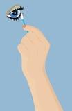 Weibliche Hand mit einem Wattestäbchen Lizenzfreies Stockfoto