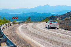 White car in turn a   road Royalty Free Stock Photography