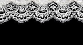 White lace on black background Stock Photography