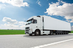 White lorry with trailer over blue sky Royalty Free Stock Photo