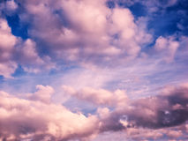 White and pink puffy clouds in blue sky Royalty Free Stock Photos