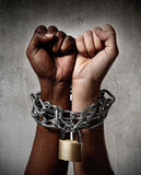 White race hand chain locked together with black ethnicity woman multiracial understanding Royalty Free Stock Image