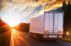 White truck on a road in the evening Stock Image