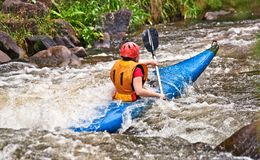 White water kayaking Stock Photography