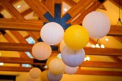 White and Yellow Paper Lanterns at Wedding Stock Photo