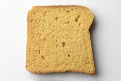 Whole wheat brown bread slice on white Royalty Free Stock Photos