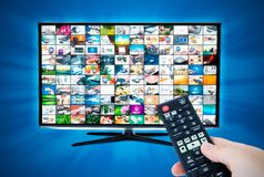 Widescreen high definition TV screen with video gallery. Remote Royalty Free Stock Image