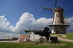 Windmill and cannon Stock Photography