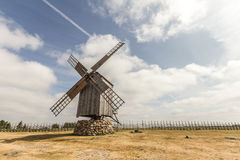 Windmill By The Fence Stock Image