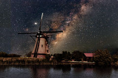A Windmill and the milky way Royalty Free Stock Photography