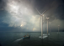 Windmill in ocean Stock Images