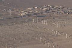 Windmills and smog Stock Photo