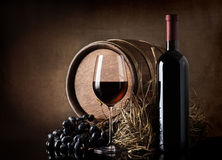 Wine with barrel and hay Royalty Free Stock Photography