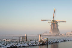 Winter landscape in the Netherlands with a windmill Stock Photography