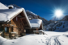 Winter ski chalet and cabin in snow mountain Stock Photo