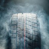 Winter tire in smoke Stock Images