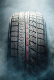 Winter tire in smoke Royalty Free Stock Image