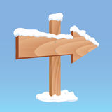Winter wooden arrow board Royalty Free Stock Images