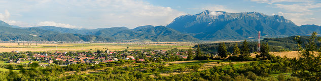 Wolkendorf village and bucegi mountain Stock Images