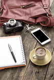Woman bag stuff and coffee Royalty Free Stock Photography