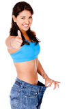 Woman in baggy pants Stock Image