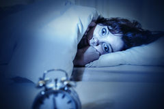 Woman in bed with eyes opened suffering insomnia and sleep disorder Royalty Free Stock Photo