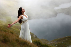 Woman breathing fresh mountain air Stock Photography