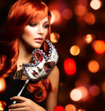 Woman with the Carnival mask Stock Photography