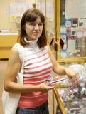Woman chooses nail varnish Royalty Free Stock Images