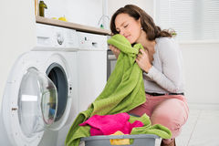 Woman With Clothes Near The Washer Stock Images
