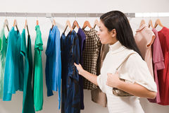 Woman in clothes shop Royalty Free Stock Images
