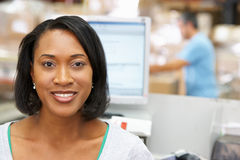 Woman At Computer Terminal In Distribution Warehouse Royalty Free Stock Image