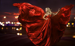 Woman dancing in silk dress, artistic red blowing  Royalty Free Stock Photo