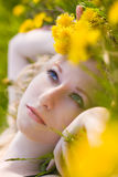 Woman with dandelions Royalty Free Stock Photography
