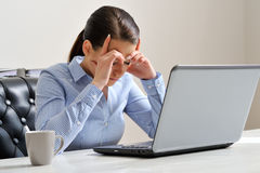 Woman depressed at work Stock Images