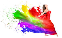 Woman dress turning into color paint Stock Photo