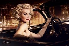 Woman driving retro convertible Stock Photos