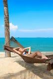 Woman enjoying the serenity of a tropical beach Stock Photos