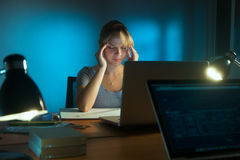Woman With Eyes Tired Working Late At Night In Office Stock Photo