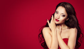 Woman Face Nails on Red, Fashion Model Makeup Beauty Portrait Royalty Free Stock Images