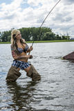 Woman fly fishing Royalty Free Stock Photo