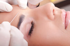 Woman get a botox injection Royalty Free Stock Images