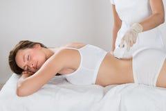Woman Getting Epilation Laser Treatment Stock Photo
