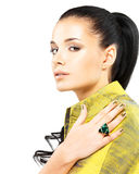 Woman with golden nails and precious stone emerald Royalty Free Stock Images