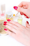 Woman hand with nail varnish Royalty Free Stock Images