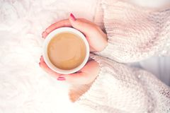 Woman hands holding a cup of hot coffee, espresso on a winter, cold day Stock Photography