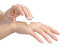 Woman hands with perfect manicure applying moisturizer cream Stock Photos