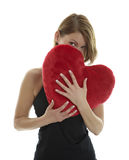 Woman with heart pillow Stock Photography