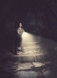 Woman holding a glowing Bible in the forest Royalty Free Stock Photography