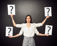 Woman holding placards with question mark Stock Photos
